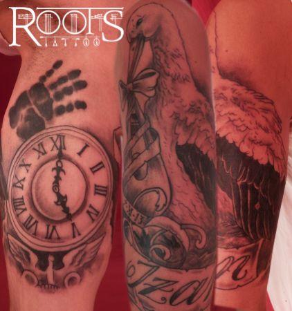 Tatuaje ave y reloj