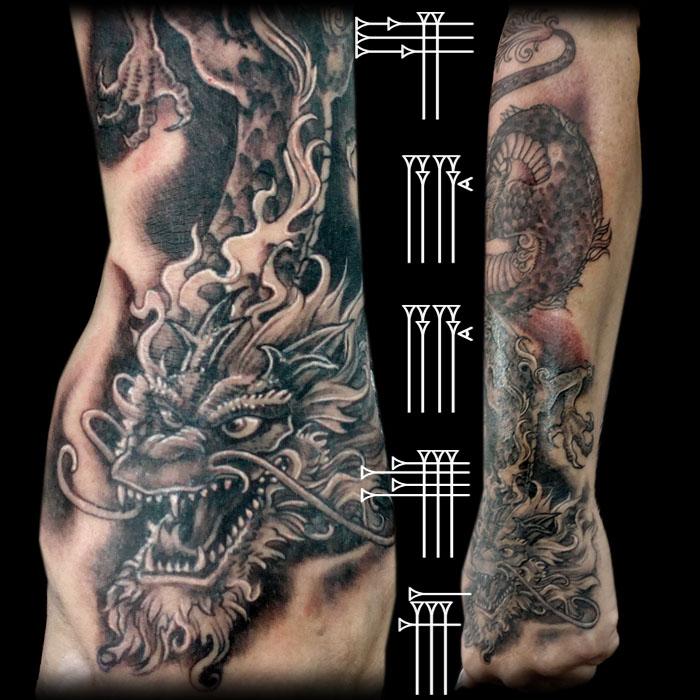 tauaje dragon en el brazo