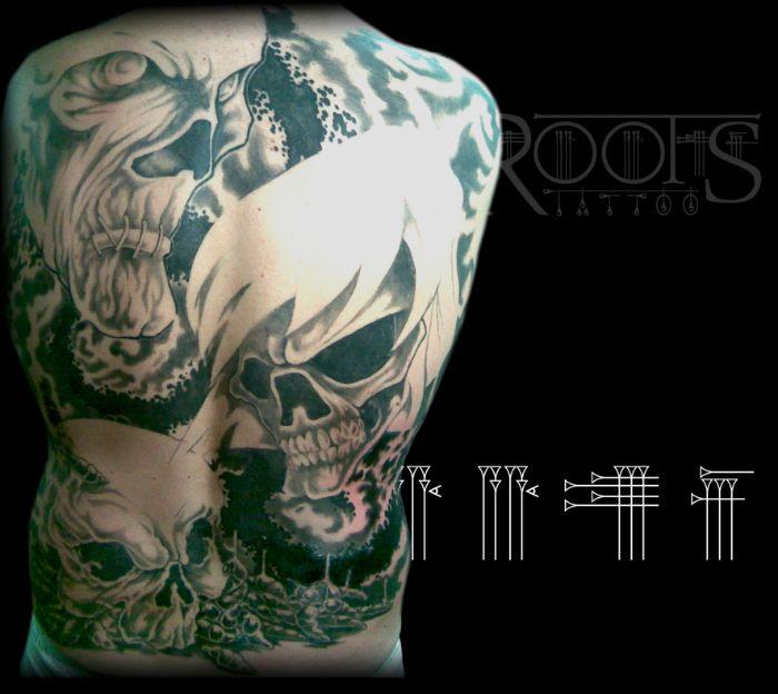 Backpiece Tattoo black and grey