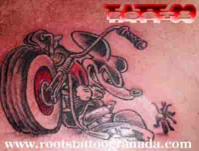 Cartoon tattoo Mickey on a chopper