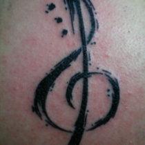 Nota musical con salpicaduras de tinta