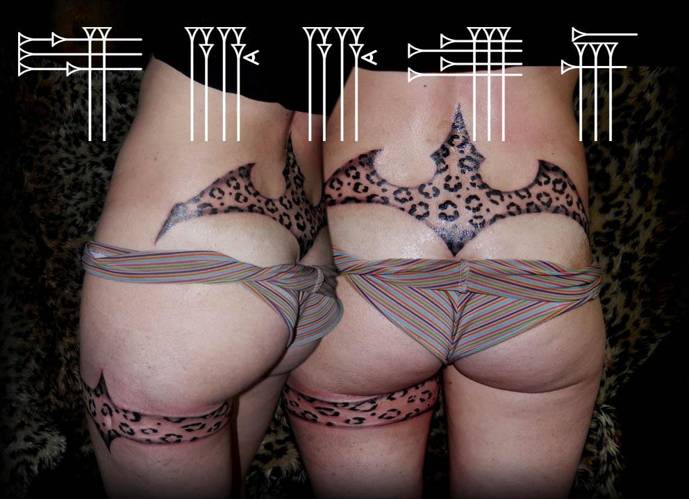 Tatuaje femenino espalda baja
