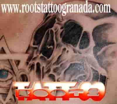 Skull man chest tattoo