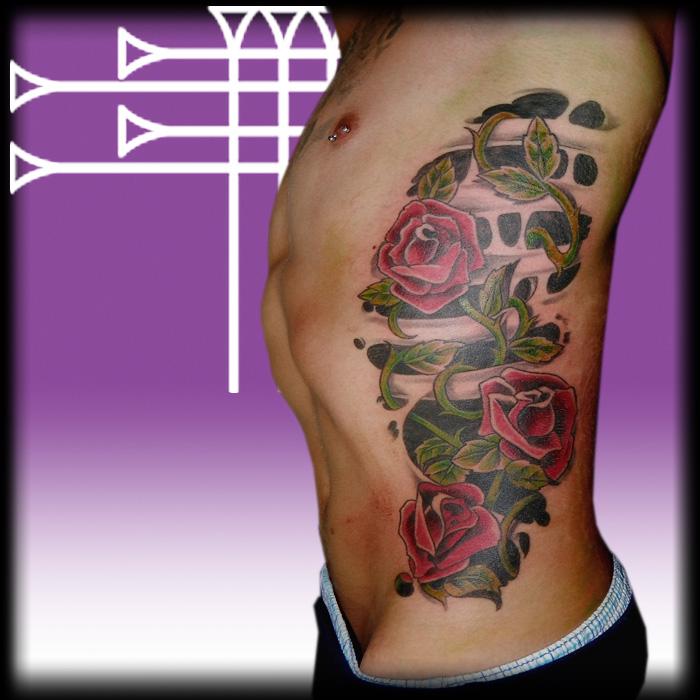 Tatuaje De Costillas Con Enredadera De Rosas Roots Tattoo Granada