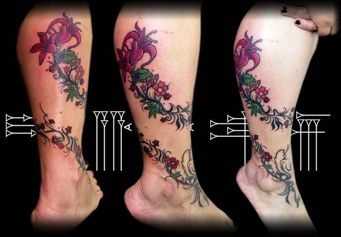 Flowers tattoo on girl leg