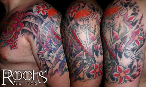 Tatuaje bleach y flor de loto y de cerezo